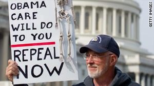 A protester outside the Capitol calls for repeal of the health care reform law on November 15.