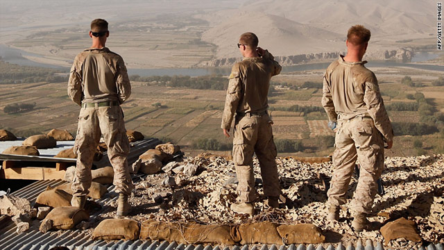 U.S. Marines look out over the Helmand River from an outpost in Kajaki, Afghanistan.