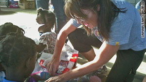 Sarah Palin visits with children after her arrival Saturday in Haiti.