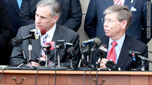 Texas Attorney General Greg Abbott, left, and Florida Attorney General Bill McCollum discuss the case.