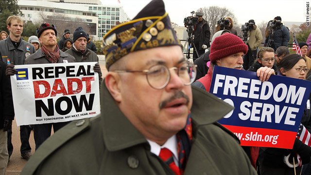 "Activists listen during a December 10 rally against the military's ""don't ask, don't tell"" policy on Capitol Hill in Washington."