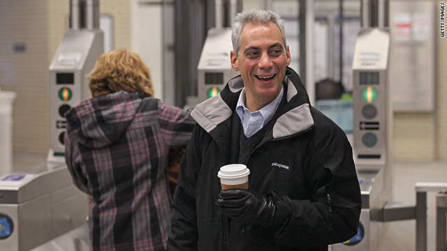 Rahm Emanuel greets commuters at a Chicago transit station on Thursday.  He's been cleared to run for mayor.