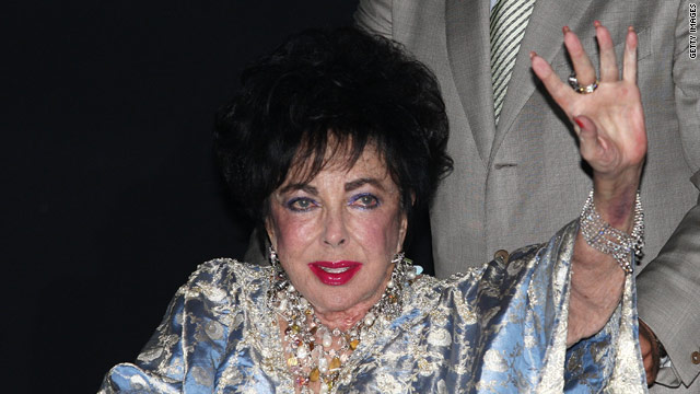 Elizabeth Taylor is denying rumors she is engaged to her manager.