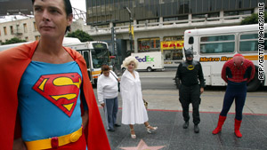 Superheroes, who sometimes ask for tips, have been targeted by Los Angeles police.