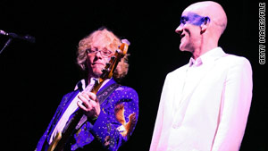 R.E.M. bassist Mike Mills, left, says the threater represents &quot;many nights of music and fun for me.&quot;