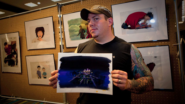 """Joe Peacock shows off his prized """"Akira"""" background, which inspired """"The Art of Akira."""""""