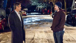 "George Clooney with Director Jason Reitman on the set of ""Up in the Air."""
