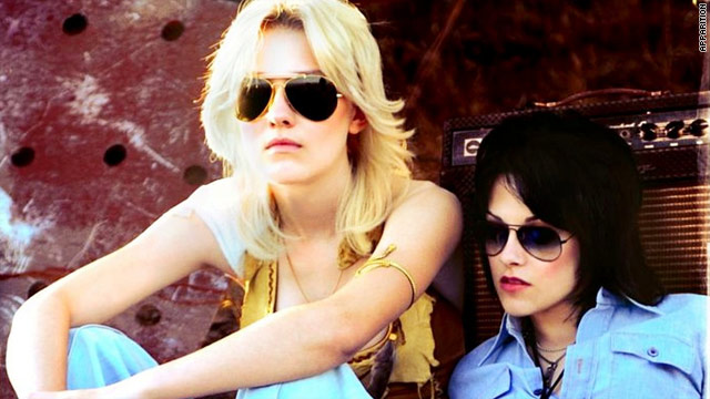 "Dakota Fanning and Kristen Stewart star as Cherie Currie and Joan Jett in ""The Runaways."""
