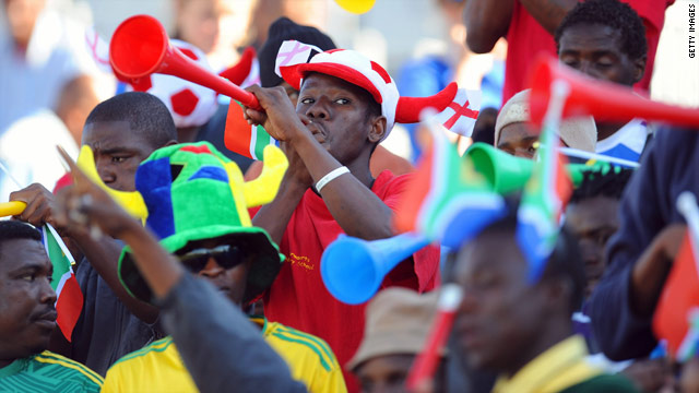 Fans at the 2010 FIFA World Cup in South Africa blow vuvuzelas during a game.