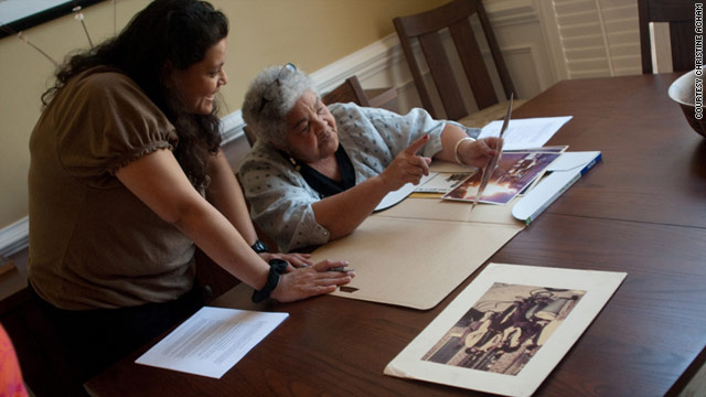 "Christine Acham looks over images with Ivan Dixon's widow, Berlie, for a documentary on ""The Spook Who Sat by the Door."""