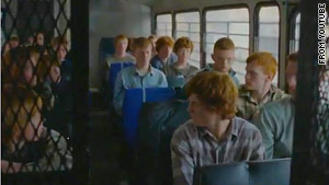 "The ""Born Free"" music video features the rounding up and terrorizing of red-headed males."
