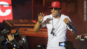Rapper T.I., here performing recently in New York, served time after being sentenced on federal weapons charges.