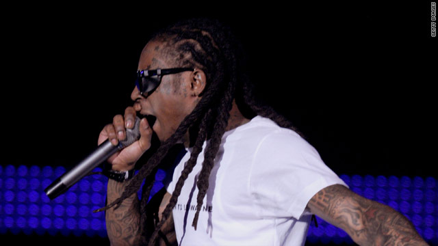 """Just two days out of prison, Lil Wayne returned to the stage last night, joining Drake midway through their single """"Miss Me."""""""