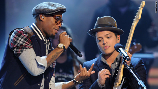 Rapper B.o..B. and musician Bruno Mars perform at the Grammy Awards nominations concert.