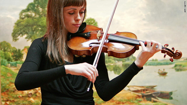 Violinist Ruth Palmer plays a 1729 Stradivari violin similar to one stolen -- the missing one is worth more than a million dollars.