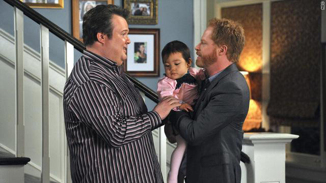 """Modern Family's"" Cameron (Eric Stonestreet) and Mitchell (Jesse Tyler Ferguson) and their adopted daughter Lily."