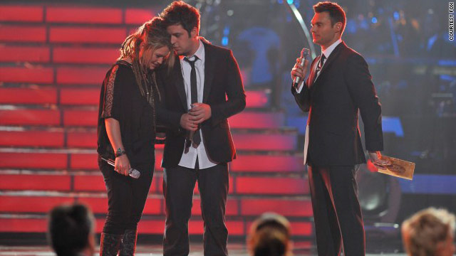 "Crystal Bowersox and Lee DeWyze lean on each other just before Ryan Seacrest reveals DeWyze as the new ""American Idol."""