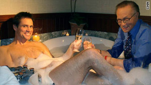 Larry King meets with actor Jim Carrey in a bathtub.