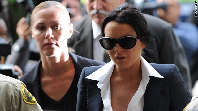 Actress Lindsay Lohan, in sunglasses, arrives for a court hearing where the judge imposed new bail conditions.