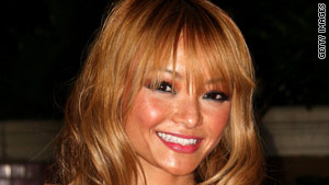 Tila Tequila says she was attacked while performing at a concert in Illinois.