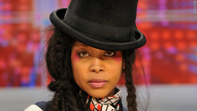 "Singer Erykah Badu stripped down on the streets of Dallas, Texas, for her ""Window Seat"" music video."