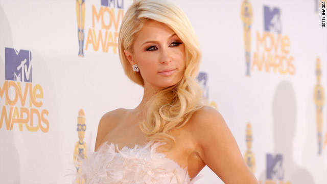 A man bearing knives was captured by police after trying to break into Paris Hilton's Los Angeles, California, home on Tuesday.