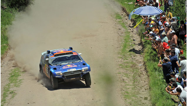 Al-Attiyah powers through in his Volkswagen with spectators in close attendance in the Dakar Rally.