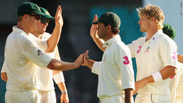 Australia players celebrate taking the wicket of Umar Gul during the second day's play in Sydney.