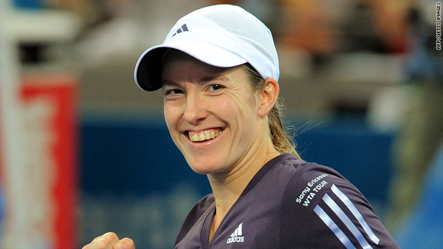 Justine Henin is all smiles after winning her comeback match at the Adelaide International tournament.