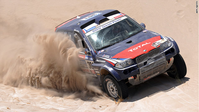Peterhansel powers through the sands during his dominant third stage display.