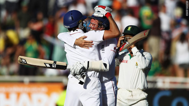England tail-enders Graham Onions and Graeme Swann celebrate England holding-on to claim a last-gasp draw againt South Africa.