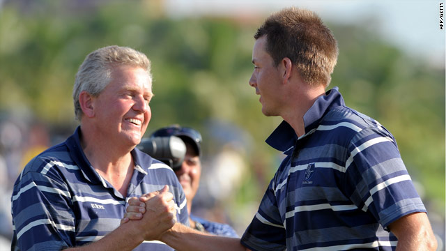 Europe captain Montgomerie (left) congratulates Stenson on his clinching half in Bangkok.