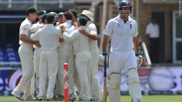 England captain Andrew Strauss cuts a dejected figure as South Africa fast bowler Dale Steyn is mobbed by his teammates.