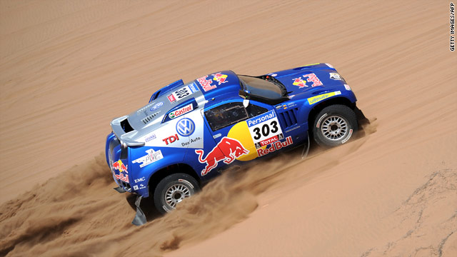 Volkswagen driver Carlos Sainz claimed victory in the 12th stage of the Dakar Rally to maintain his overall lead.