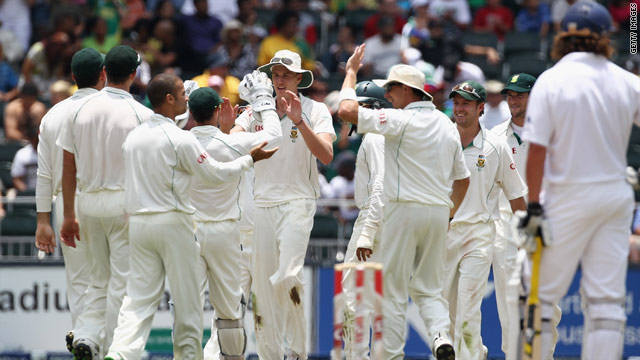 Morne Morkel (center) celebrates with team-mates after taking another wicket during South Africa's innings success.
