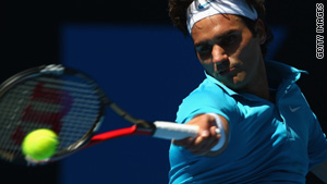 Roger Federer returns a shot against Igor Andreev in match play on Tuesday.