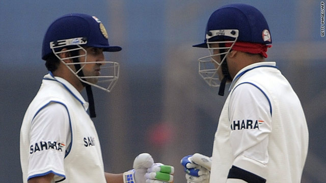 Gautam Gambhir and Virender Sehwag celebrate a boundary during their side's 413 for eight as Gambhir made a century.