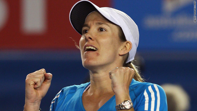 Justine Henin celebrates her 7-5 7-6 (8-6) victory over fifth seed Elena Dementieva at the Australian Open in Melbourne.