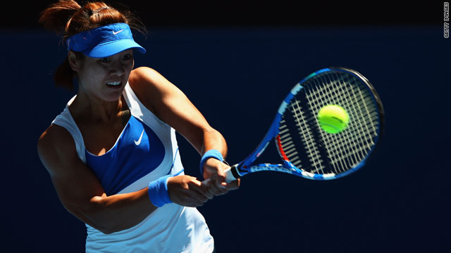 Li Na of China returns a backhand against Caroline Wozniacki of Denmark.