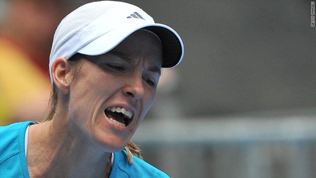 Justine Henin had a real battle before getting past compatriot Yanina Wickmayer.