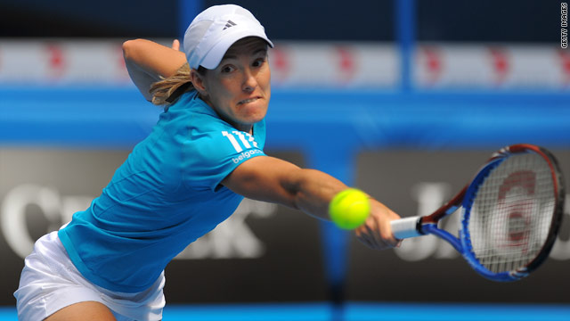 Belgian Justine Henin saw off a tough challenge from Russia's Nadia Petrova to secure a spot in the Australian Open semifinals.