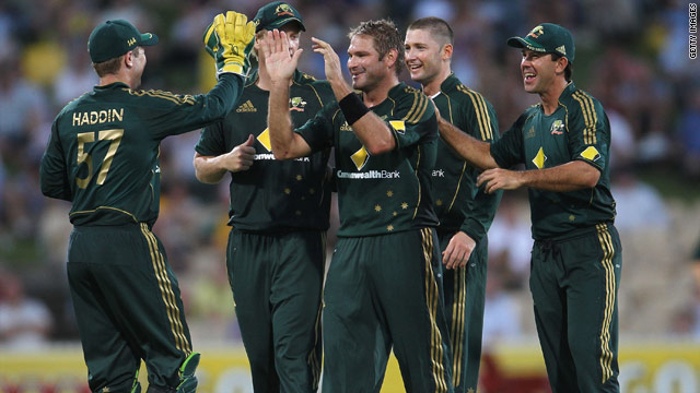 Ryan Harris is mobbed by his teammates after taking five wickets to help Australia defeat Pakistan in Adelaide on Tuesday.