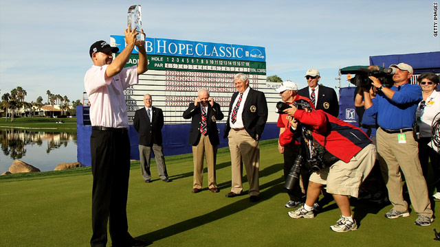 American Bill Haas celebrates his victory at the Bob Hope Classic which his father had won back in 1988.