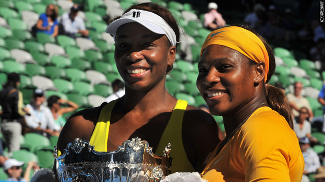 Venus and Serena (right) were winning the Australian Open doubles title for the fourth time.