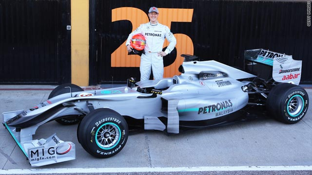 Michael Schumacher poses with the new Mercedes car ahead of his return to F1 testing on Monday.
