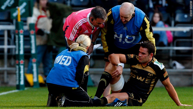Lee Byrne receives treatment on the field during the Osprey's European Cup win against the Leicester Tigers.