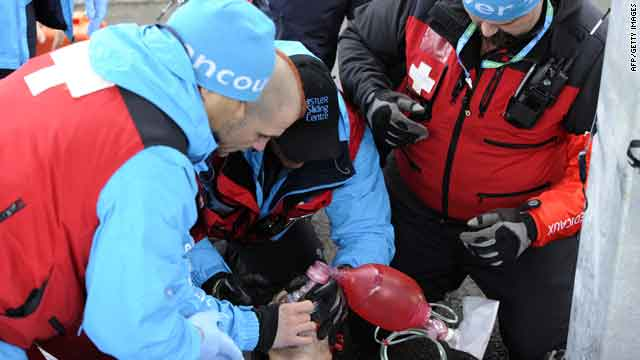 Medics assist Georgian luge hopeful Nodar Kumaritashvili after his crash during luge practice in Vancouver on Friday.