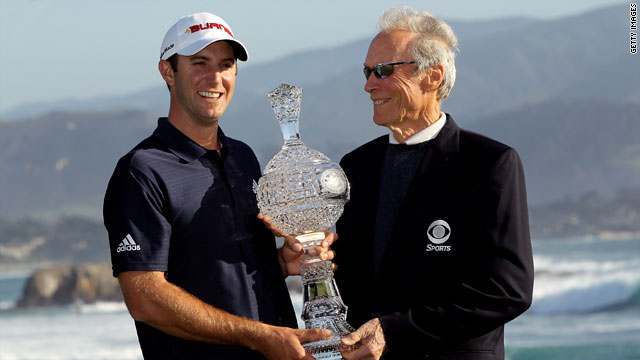 Dustin Johnson is presented with the Pebble Beach National Pro-Am Trophy from actor and director Clint Eastwood