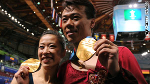 China's Shen Xue and Zhao Hongbo are all smiles Monday night after winning the pairs figure skating gold.