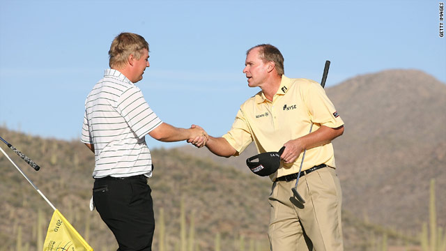 Ross McGowan (left) shakes hands with top seed Steve Stricker after beating him on the first extra hole.